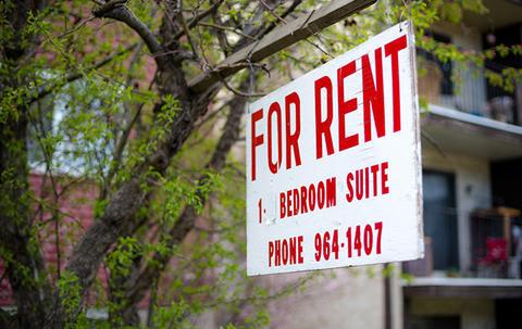 hanging 'for rent' sign