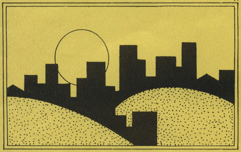 black silhouette of buildings on yellow hillsides